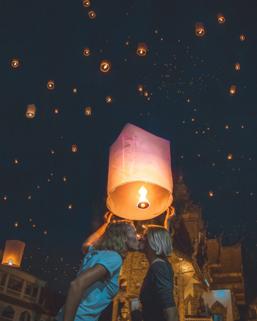 Us - a lesbian couple - kissing below a wish balloon/lantern during the Chiang Mai lantern festival Yi Peng