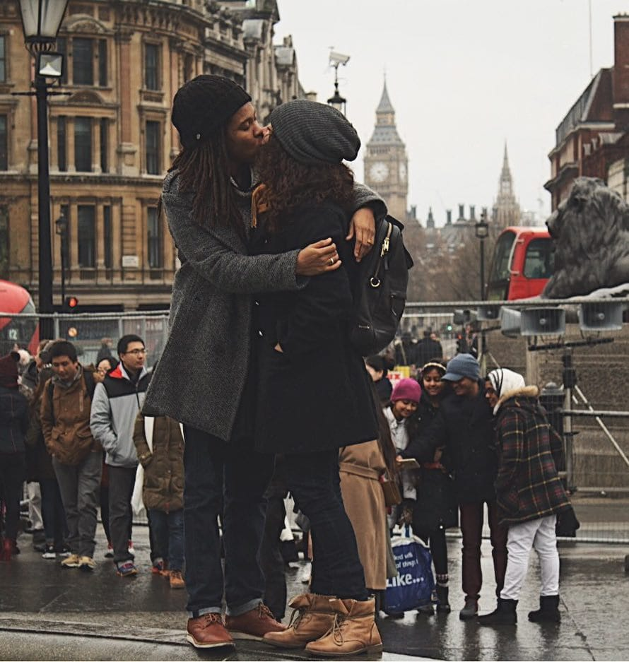 Lesbian instagram travel couple Steph and Tay, Lesbenomadic, kissing on a street in London, England, celebrating legalisation same sex marriage