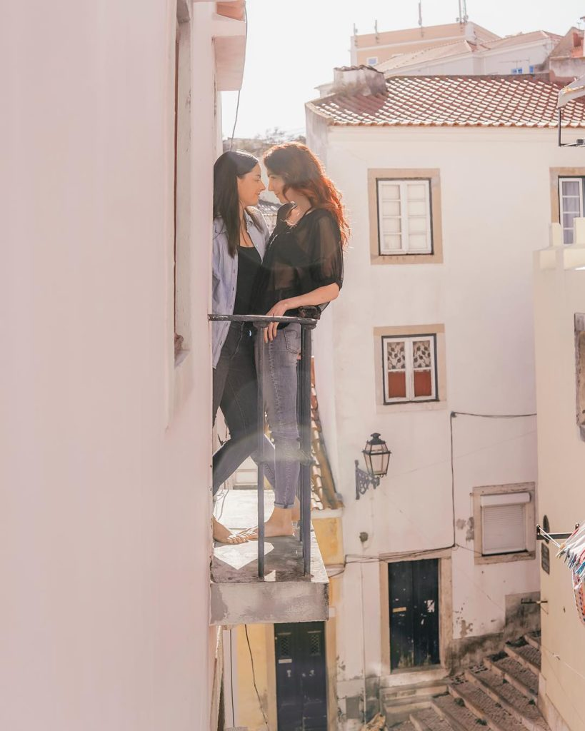 Lesbian blogger and instagram travel couple Kaitlyn and Stephanie, Lez See the World, on a romantic balcony in Lisbon, Portugal