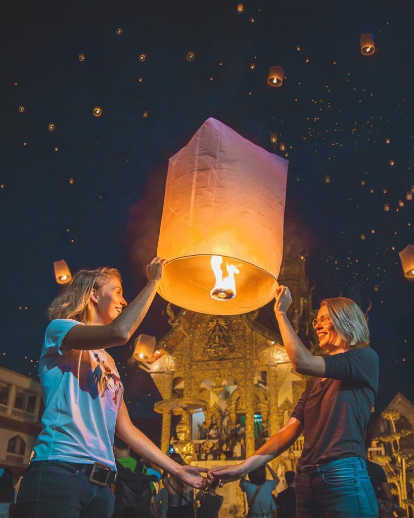 Lesbian blogger, youtube and instagram travel couple Roxanne and Maartje, onceuponajrny, Once Upon A Journey celebrating engagement during Chiang Mai lantern festival, Thailand
