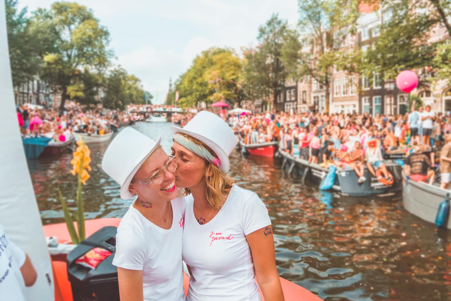 Amsterdam Pride, canal pride, canal parade, the Netherlands, LGBT pride, gay pride, lesbian couple, lesbian couple celebrating pride