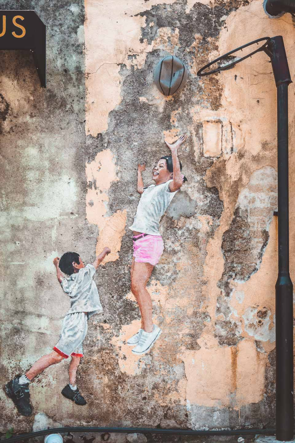 Children playing basketball by Louis Gan Yee Loong, Penang Street Art, Malaysia