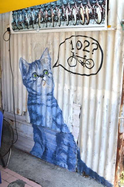 102nd cat mural question mark bicycle cat, Penang Street Art by Cailin O'Neil