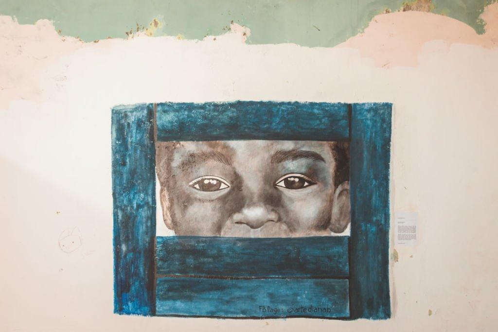 Boy looking through blue window mural, Art Lane Penang Street Art, Malaysia