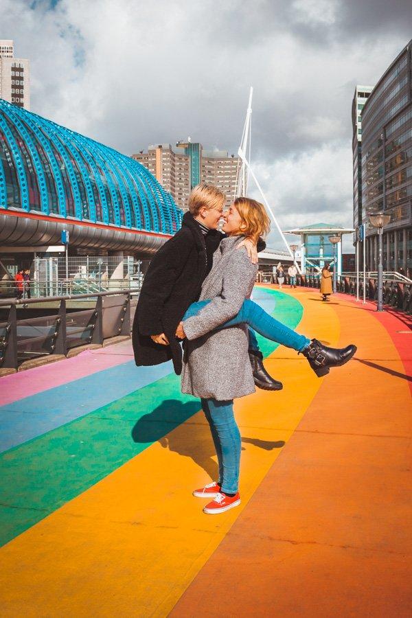 Lesbian couple on rainbow crosswalk