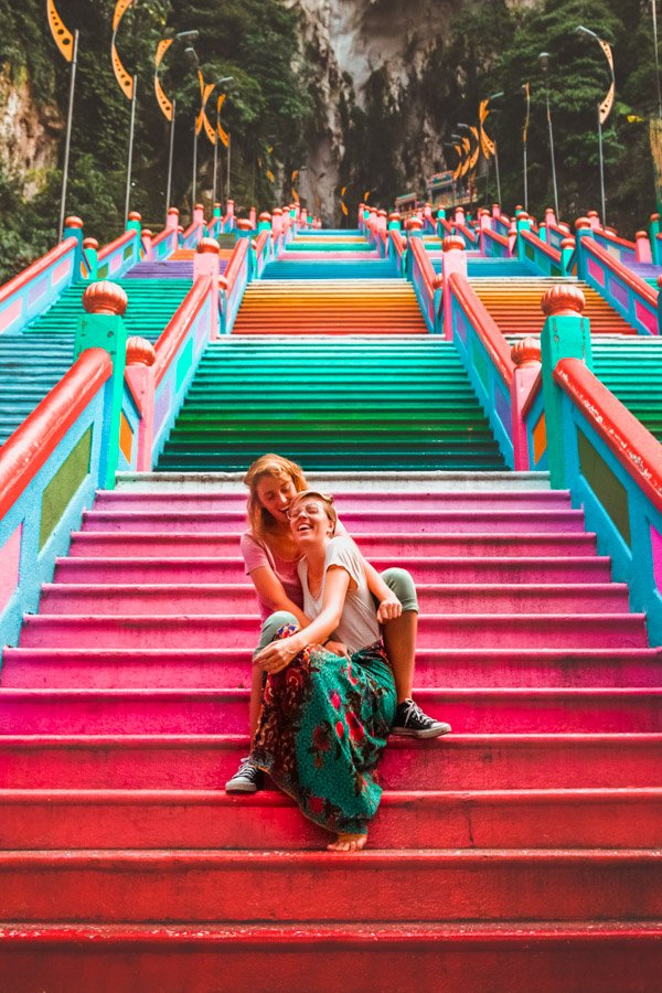 Gay couple on rainbow stairs Batu Caves, Malaysia