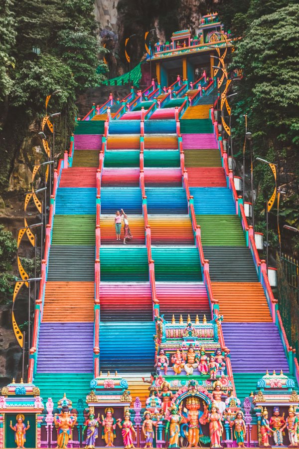 Lesbian couple on rainbow stairs at Batu Caves, Malaysia
