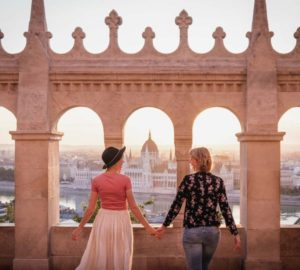Gay couple walking hand in hand at the Fisherman's Bastion in Budapest, Hungary
