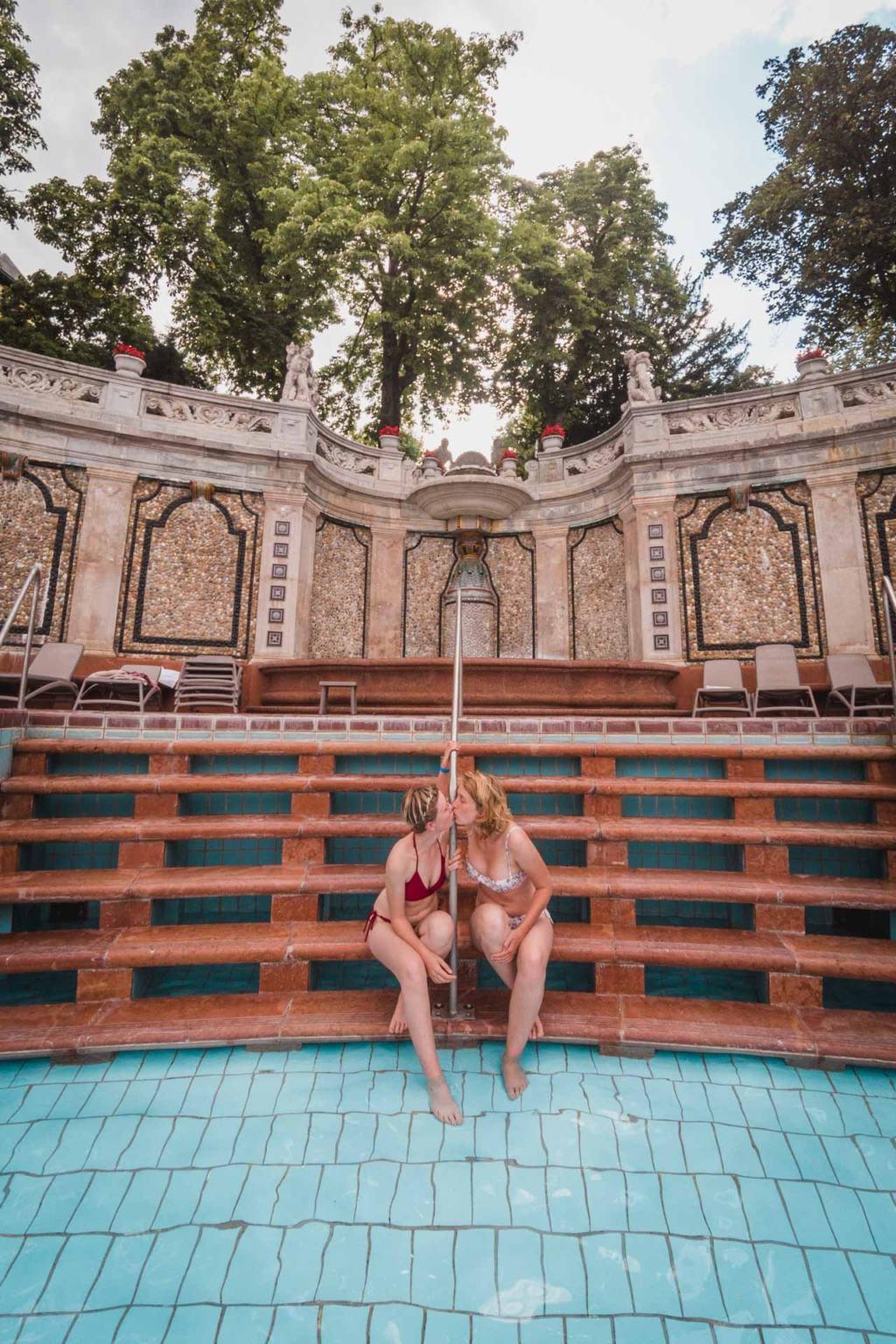 Lesbian couple kissing at Géllert Baths, Budapest, Hungary