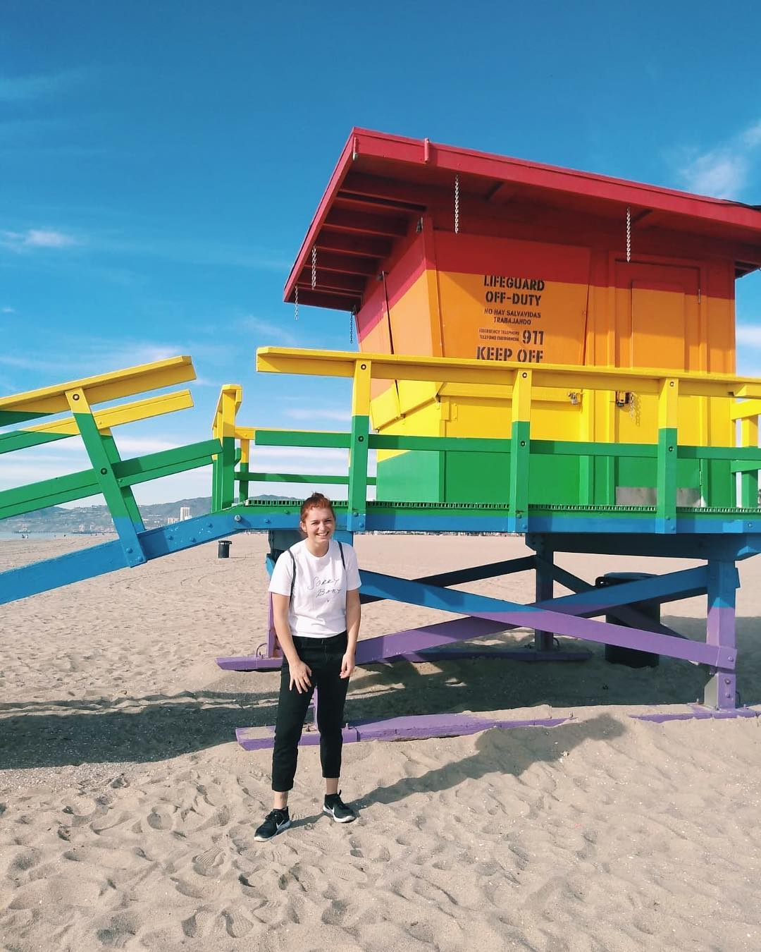 Venice Pride Lifeguard Tower in Los Angeles with lesbian local Esmee