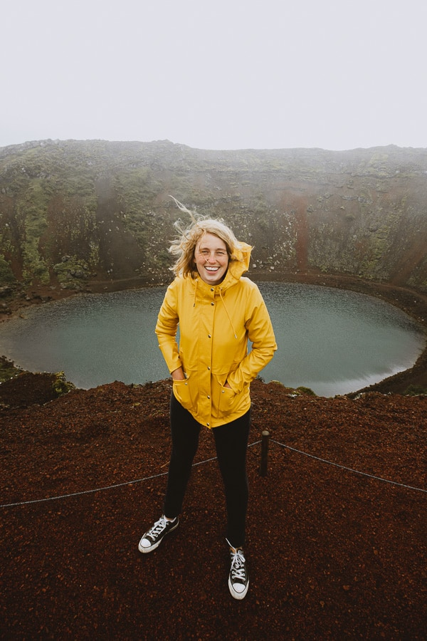 Girl in yellow rain coat best Iceland jacket Kerid Crater Golden Circle