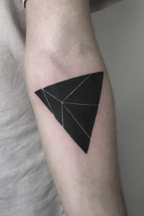 Tattoo of a black triangle divided into six parts by white lines on the left forearm Tattoo Ideas Tattoo Grid