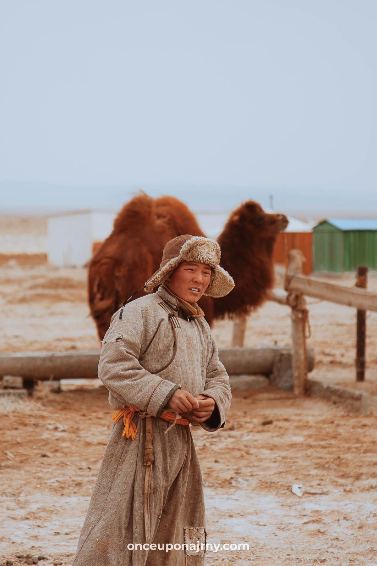 Mongolian boy and camel