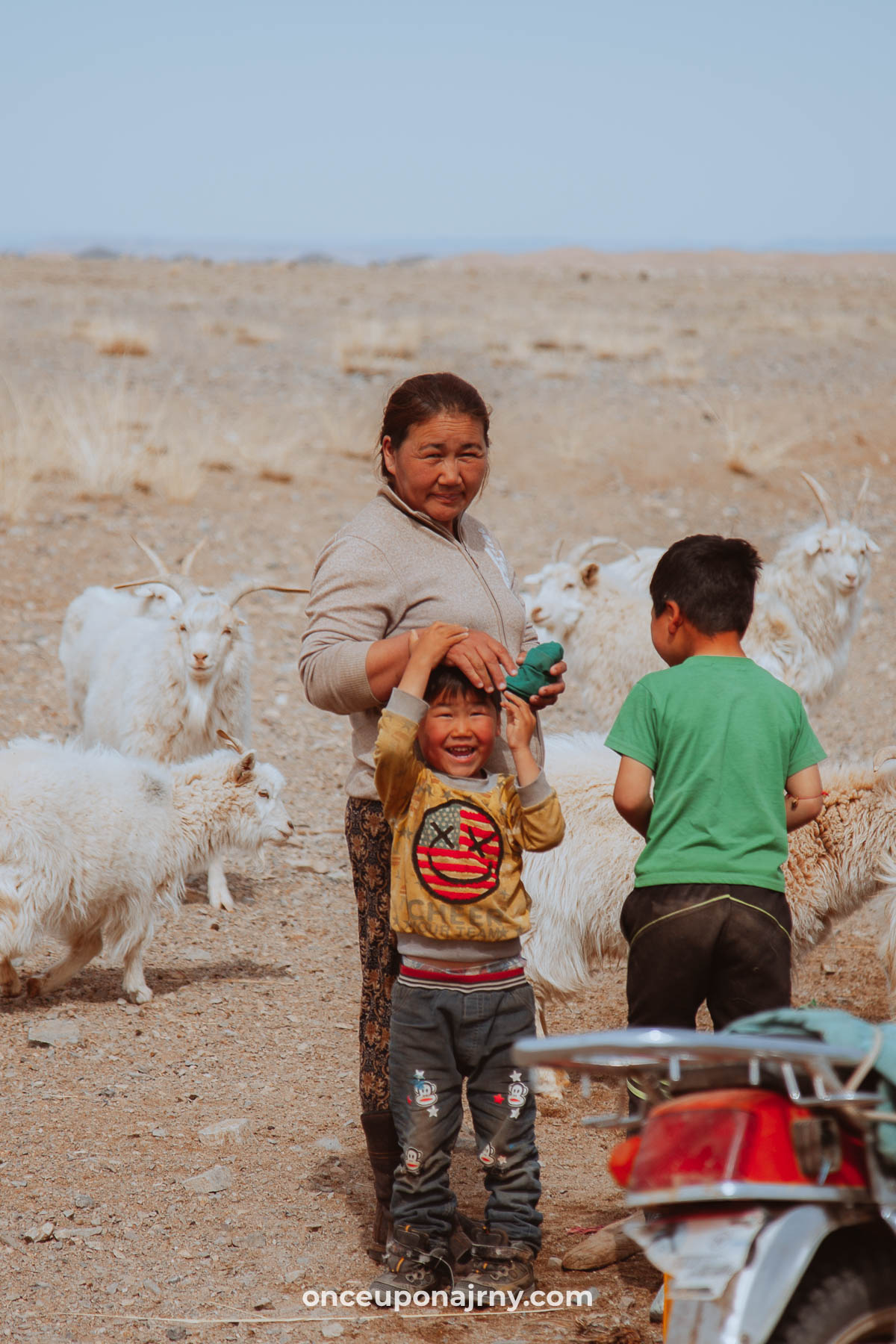 Mongolian family with goats