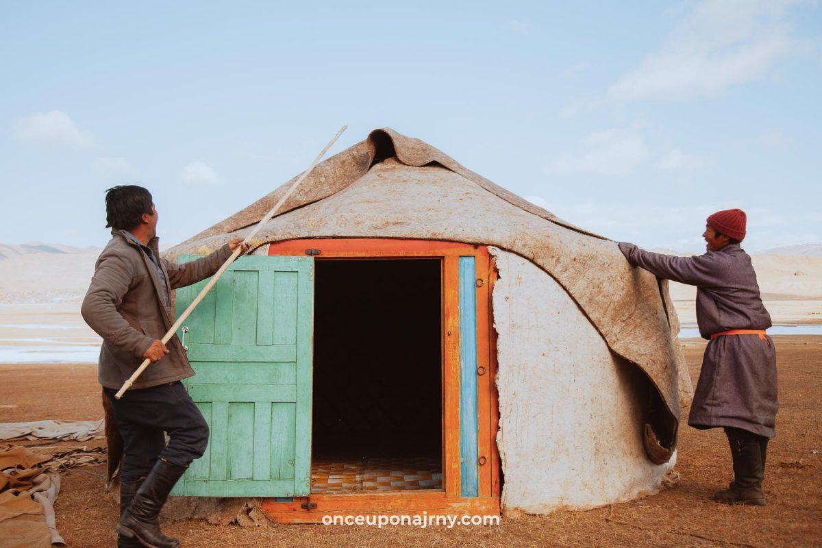 Mongolian people setting up a yurt ger